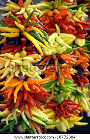 Colorful chili peppers on display at a farmers market - stock photo