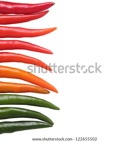 Colorful chillies border isolated on white background. These chilies are in red(crimson), orange and green colors.