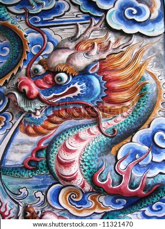 Colorful Chinese Dragon on wall - stock photo