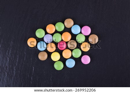 Colorful Chocolate Coated Candies on a Dark Background.   - stock photo