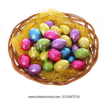 colorful chocolate easter eggs in basket isolated on white background - stock photo