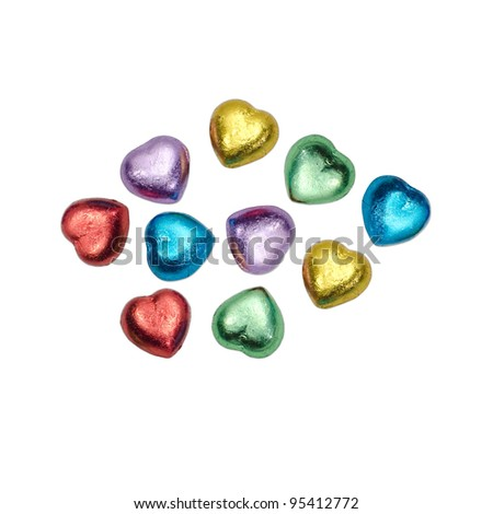 colorful chocolate hearts candies on white background,isolated - stock photo