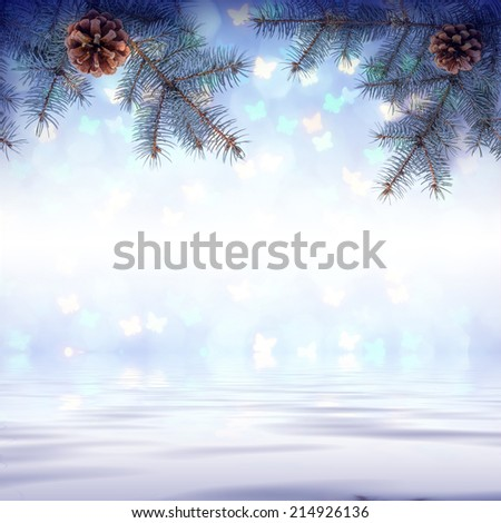 Colorful Christmas background with fir branch reflected in water - stock photo
