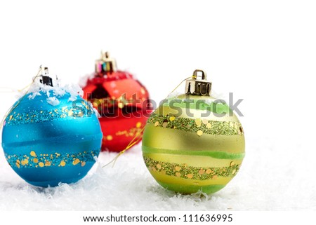 Colorful Christmas baubles on white isolated background