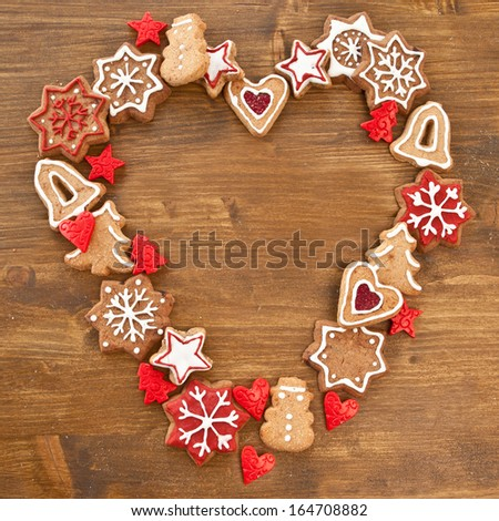 Colorful christmas cookies on rustic wooden background