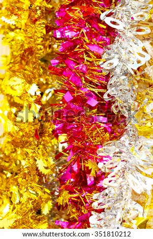 Colorful christmas tinsel texture and background