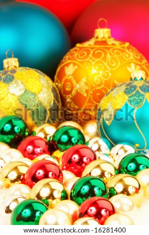 Colorful Christmas tree ornaments focus on the foreground, blurred background