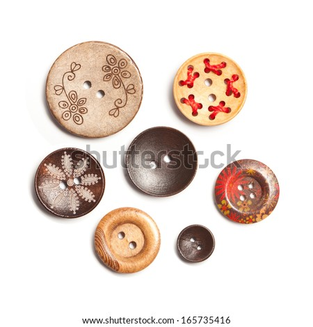 Colorful Clasper, Buttons made of wood isolate on white background - stock photo