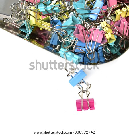 Colorful clip on white background - stock photo