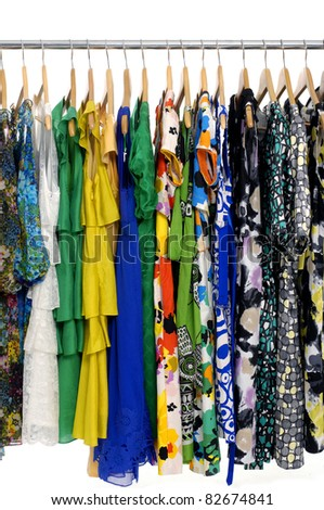 colorful clothes choice of casual clothes on wooden hangers - stock photo