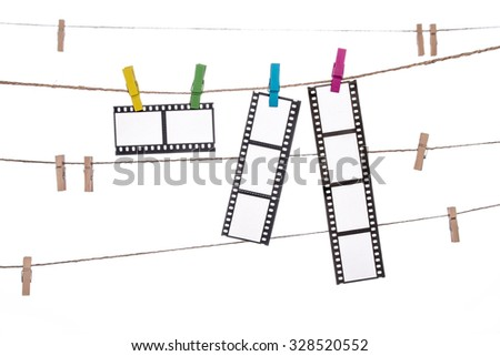 colorful clothespins on a clothesline , hanging Photographic Negatives image - stock photo