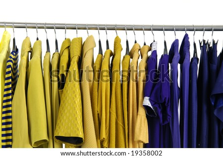 Colorful clothing autumn/winter on a rack on black hangers