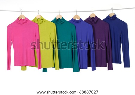 colorful clothing on hanger rack display