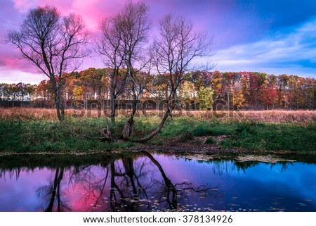 Colorful Clouds and Sky in Autumn. Sunrise Sunset Reflection in Flowing Water. Peaceful Tranquil Serene Nature Background. - stock photo