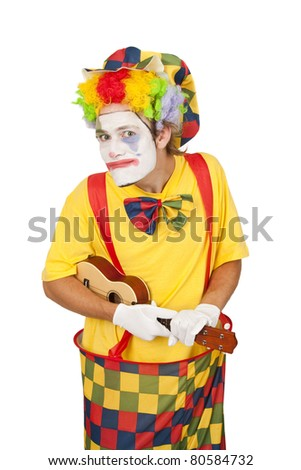 Colorful clown with ukulele isolated on white background - stock photo