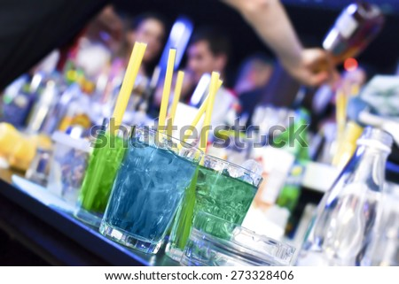 Colorful cocktails in a bar - stock photo