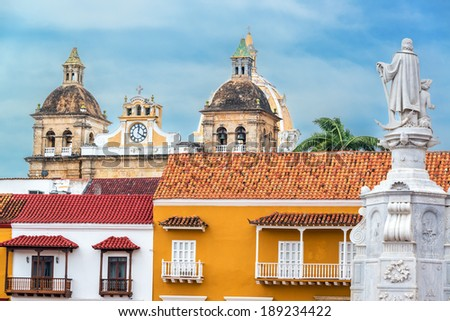 Colorful colonial buildings with the church of San Pedro Claver in the background in the historic center of Cartagena, Colombia - stock photo