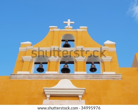 Colorful colonial church with bells in the central part of the city of Campeche, Yucatan, Mexico. - stock photo