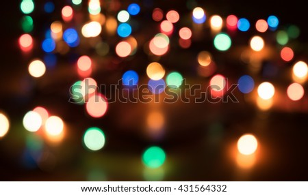 Colorful color light bokeh blur background. Out of focus light bulb.