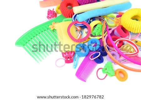 Colorful comb,barrette and Scrunchy isolated on white - stock photo