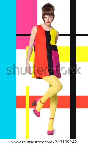 Colorful concept in sixties retro fashion style with Caucasian model posing full body over designed background with colorful bright stripes and color blocks. - stock photo
