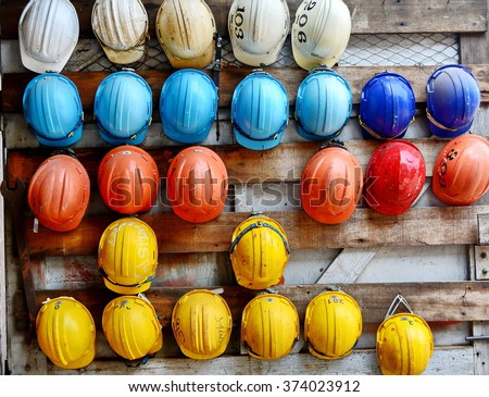 colorful construction helmets - stock photo