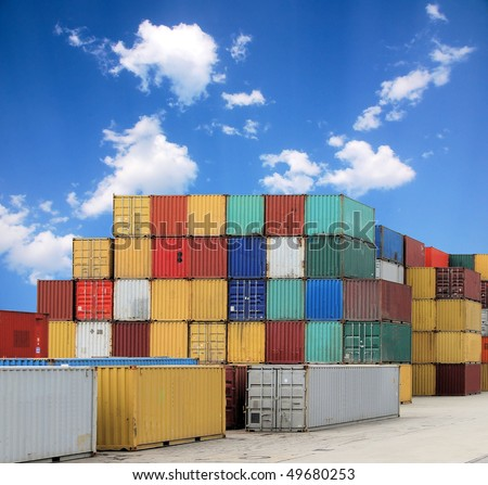 Colorful container and a blue sky with clouds
