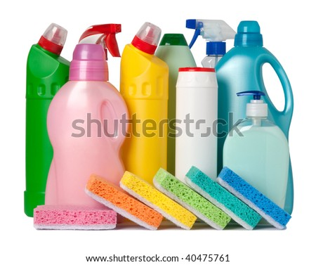 Colorful containers of cleaning supplies and sponges - stock photo