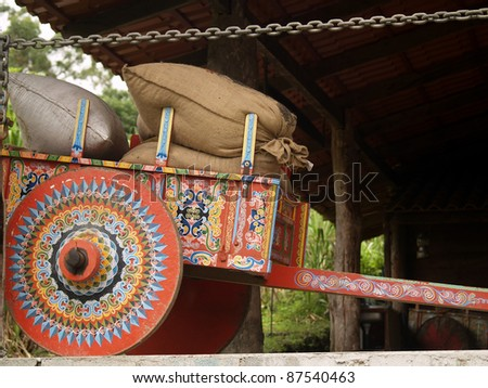 Colorful Costa Rican Ox Cart loaded with coffee bags - stock photo