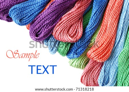 Colorful cotton craft thread on white background with copy space. - stock photo