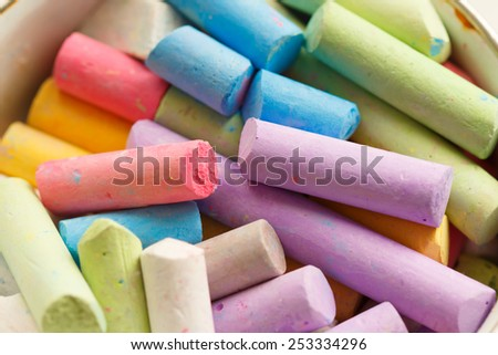 Colorful crayons for drawing on the pavement close-up - stock photo