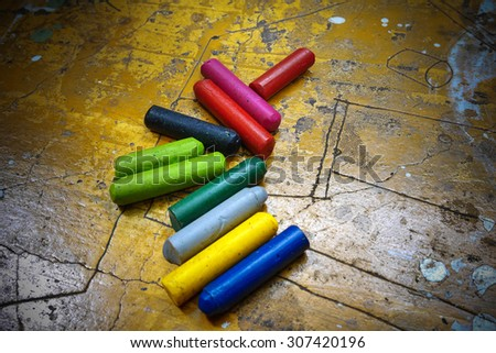 colorful crayons on wooden vintage background - stock photo