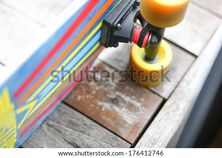 Colorful cruiser skate board with yellow wheels top view - stock photo