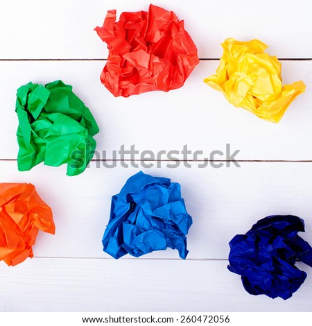Colorful crumpled paper on a white background. Mix color paper balls