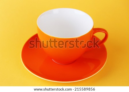 Colorful cup on color background
