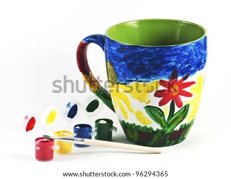 Colorful cup with watercolors and brush - stock photo