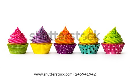 Colorful cupcakes on a white background - stock photo