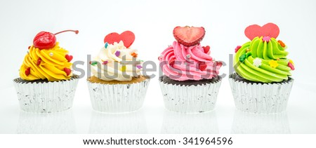 colorful cupcakes with beautiful decoration over white background