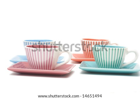 colorful cups of coffee isolated on white - stock photo