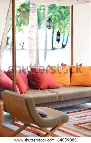colorful cushions on the outdoor couch in maldives island resort - stock photo