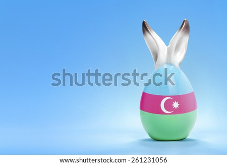 Colorful cute ceramic easter egg with rabbit ears and the flag of Azerbaijan .(series) - stock photo