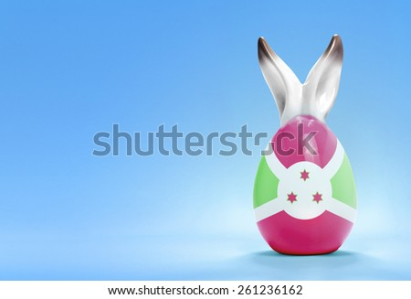Colorful cute ceramic easter egg with rabbit ears and the flag of Burundi .(series)