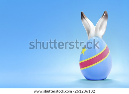 Colorful cute ceramic easter egg with rabbit ears and the flag of Democratic Republic of the Congo .(series) - stock photo
