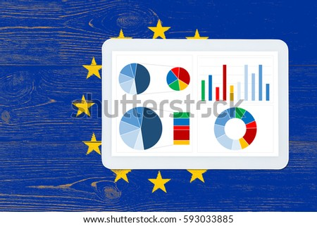 colorful dashboard over europe union flag painted table
