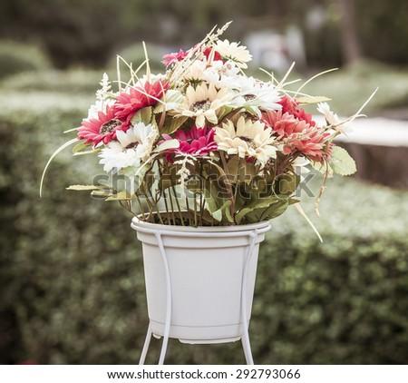 Colorful decoration artificial flower, Vintage color . - stock photo