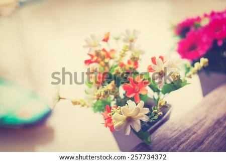 Colorful decoration artificial flower,vintage effect - stock photo