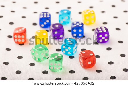 Colorful dice in close up. Concept image of leisure game, risk and chance. Symbol of success or luck. - stock photo