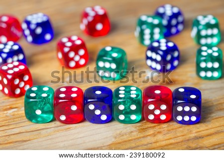 colorful dices background on wood