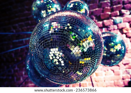 Colorful disco party background with mirror balls reflecting lights - stock photo