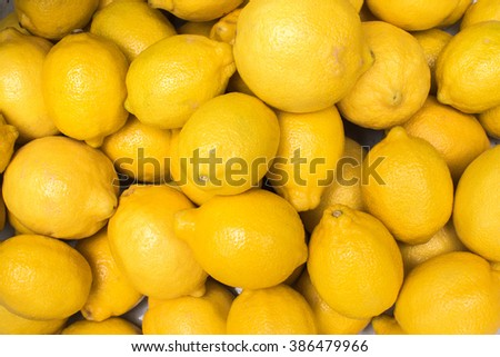 Colorful Display Of Lemons In Market